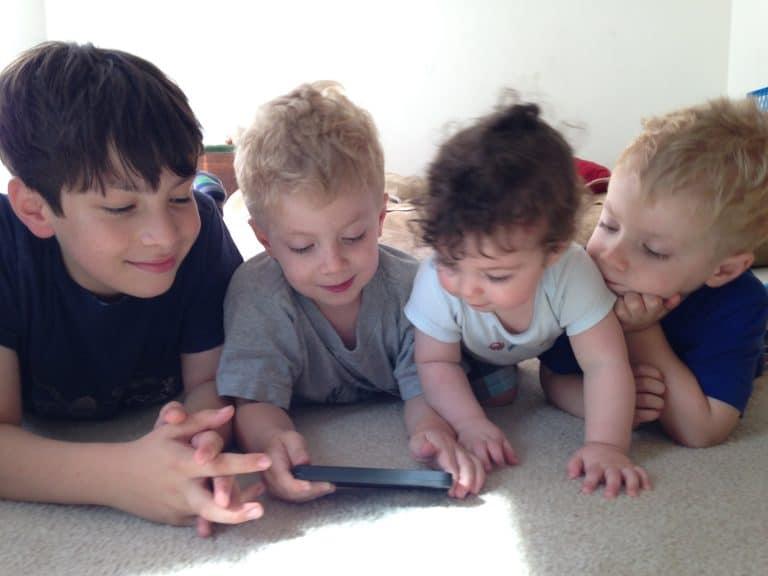 Four Boys Reading